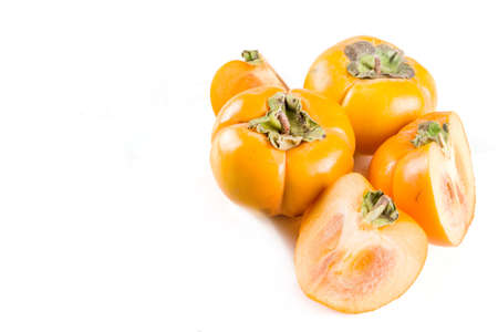 Whole and sliced persimmons, fresh organic farm fruit on a white background. Isolated, copy space 스톡 콘텐츠