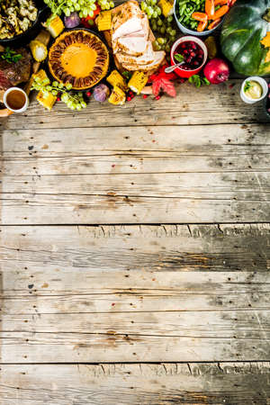 Thanksgiving family dinner setting concept. Traditional Thanksgiving day food  with turkey, green beans and mashed potatoes, stuffing, pumpkin, apple and pecan pies, rustic wooden table Stock Photo