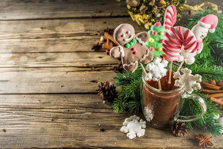 Funny christmas hot chocolate mug with marshmallow in form of gingerbread man, snowman, Christmas tree, snow flake. 版權商用圖片