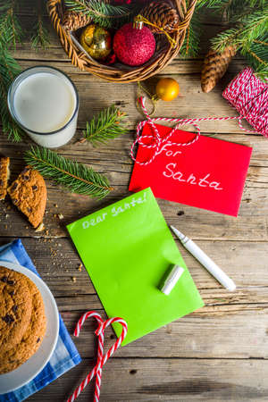 Christmas concept with milk and cookies to Santa, rustic wooden xmas greeting card background Stock Photo