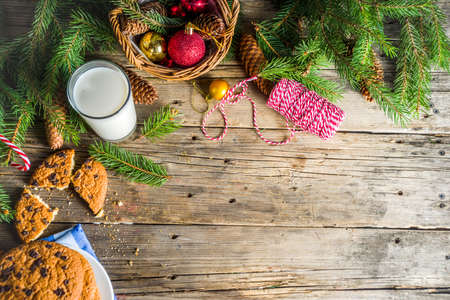 Christmas concept with milk and cookies to Santa, rustic wooden xmas greeting card background 스톡 콘텐츠