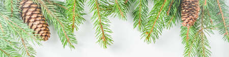 Christmas greeting card background with fir tree and decoration, white table background flat lay top view copy space