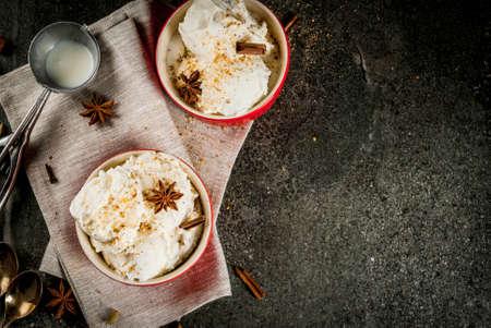 Cold Homemade Eggnog Ice Cream with Cinnamon and anise, on dark stone