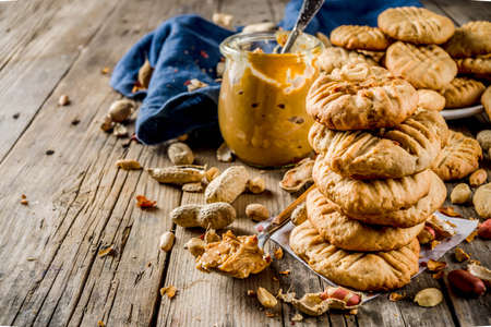 Traditional american baking, homemade Peanut Butter Cookies with peanuts and peanut butter on rustic wooden table 스톡 콘텐츠