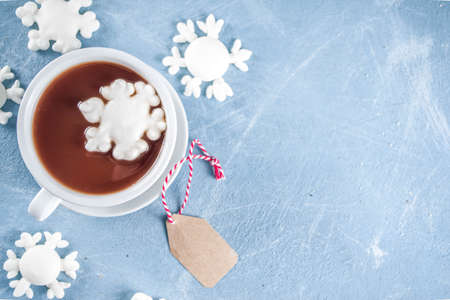 Hot chocolate cup with marshmallows snowflakes