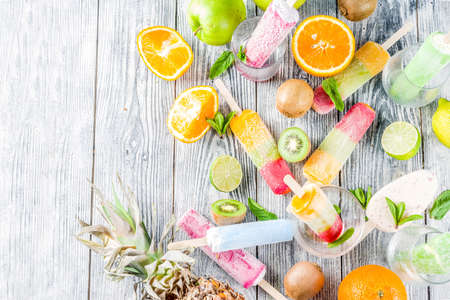 Colorful fruit ice cream with different fresh tropic fruits, wooden 스톡 콘텐츠