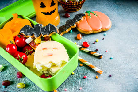 Halloween food, school lunch box with ghost sandwich 스톡 콘텐츠