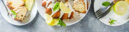 Homemade lemon bundt cake with sugar icing, fresh lemons and mint leaves, copy space