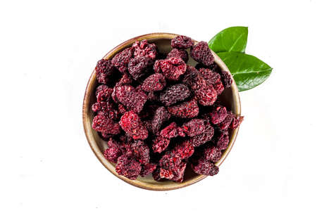 Heap of sun dried sweet raspberries isolated on white background. Top view