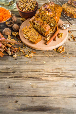 Homemade carrot cake with walnuts, rustic wooden background with ingredients, copy space Banco de Imagens - 133053557
