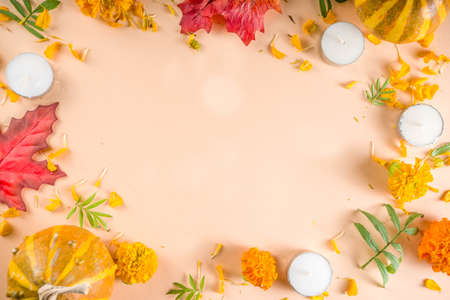 Día de Muertos, mexican day of the dead background, Traditional autumn mexican holiday, with Marigold flowers, candles, autumn leaves and pumpkins. With an inscription  Día de Muertos. Top view flatlay