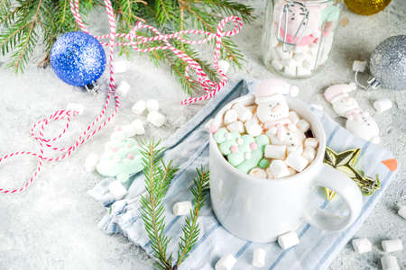 Creative idea for christmas drink, delicious hot chocolate with funny marshmallow snowman, christmas tree, rain dear, santa, on home background with xmas decoration copy space top view Reklamní fotografie