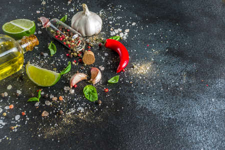 Cooking food stone concrete background with spices, olive oil, garlic, onion, pepper, herbs, basil. Top view copy space Banque d'images - 133059203