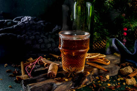 Hot autumn winter drink. Grog, warm tea with spices and dried oranges