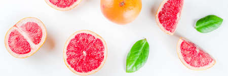 Whole and sliced grapefruit isolated on white background Foto de archivo