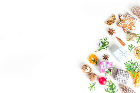 Christmas festive background with xmas fir tree branches, pine cones and decorations on white.
