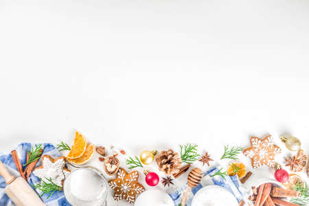 Christmas baking background. Christmas sweet cooking ingredients on white table. Ingredient for cooking christmas pastry, cookies and cakes