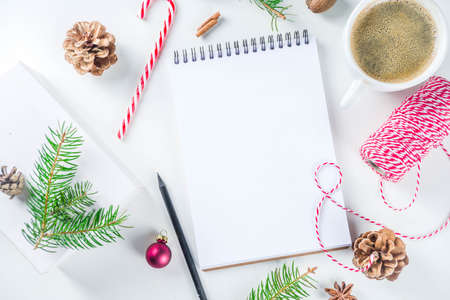 Christmas and New Year background with empty notepad, pen and christmas decorations. To do list, wishlist concept. Mock up, frame, flatlay