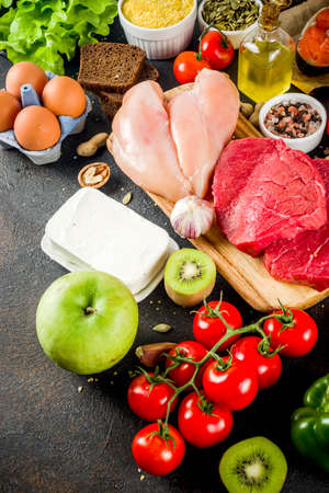 Healthy diet food. Various low food ingredients selection - meat, vegetables, berry, fruit, grains, Trendy healthy lifestyle concept. On dark rusty background copy space top view Zdjęcie Seryjne
