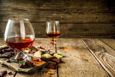 Strong alcohol drink. Glass of brandy, whiskey or cognac on the wooden table 写真素材