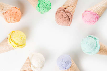 Colorful pastel ice cream with waffle cones, white background, copy space top view Stok Fotoğraf