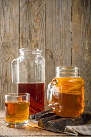 Fermented drink, Homemade sweet fermented tea Kombucha, in different jars and glasses