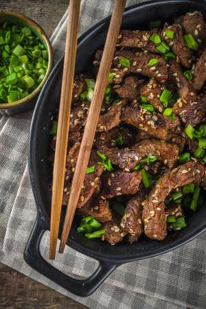 Korean BBQ dish Beef Bulgogi, with marinated rib eye beef meat slices. Traditional korean food recipe idea, copy space