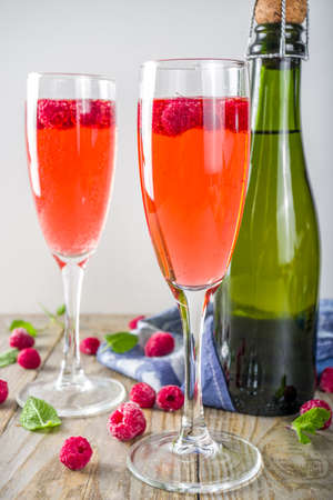 Summer refreshing Alcoholic Drink, Kir Royale Cocktail with Champagne Raspberries