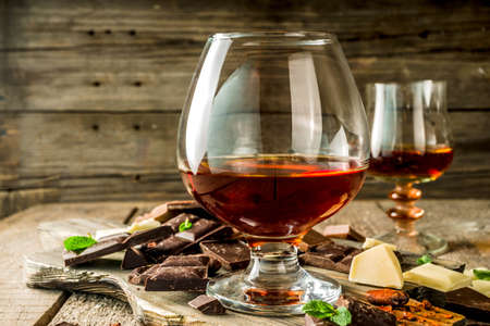 Strong alcohol drink. Glass of brandy, whiskey or cognac on the wooden table Reklamní fotografie