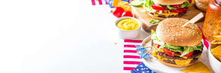Celebrating Independence Day, July 4. Traditional American Memorial Day Patriotic Picnic with burgers, french fries and snacks, Summer USA picnic and bbq concept, White concrete background Stock Photo