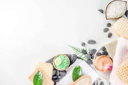 Bodycare organic cosmetics. Spa setting with basic hygiene treatment - sea salt, washcloth and natural handmade soap, and bath stuff ready for use. Zero waste bath care concept. White stone background
