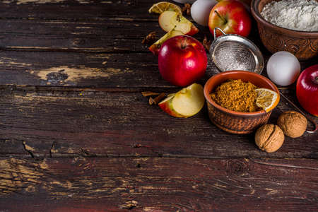 Autumn baking concept. Cooking baking background with ingredients, spices and utensils. All you need for baking traditional autumn apple pie, on rustic wooden background copy space