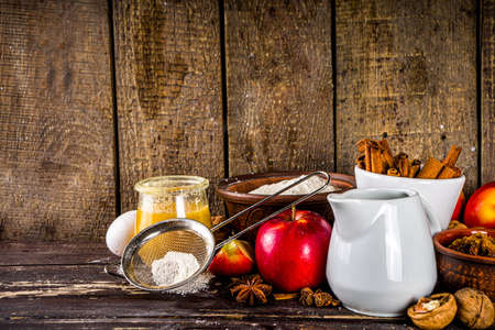 Autumn baking concept. Cooking baking background with ingredients, spices and utensils. All you need for baking traditional autumn apple pie, on rustic wooden background copy space Archivio Fotografico
