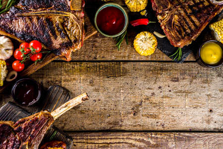 Set of various grilled meat, different beef steaks with sauces.Bbq beef steaks - chateau mignon, t-bone, tomahawk, striploin, tenderloin, new york steak. Wooden rustic background