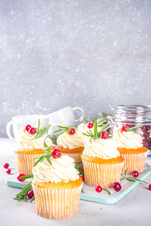 Gingerbread Christmas Cupcakes with sugared cranberry and rosemary, copy space