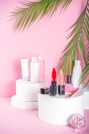 Creative background with decorative cosmetic. Beauty and body care product concept on trendy stands or podiums. Stands mockup with make up products copy space