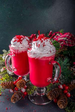 Trendy original winter Christmas hot chocolate recipe idea, Red velvet hot chocolate over festive background copy space