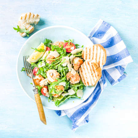 Healthy food concept, Diet salad plate. Fresh seafood salad recipe. Grilled shrimp prawns, fresh vegetable salad and egg. Reklamní fotografie