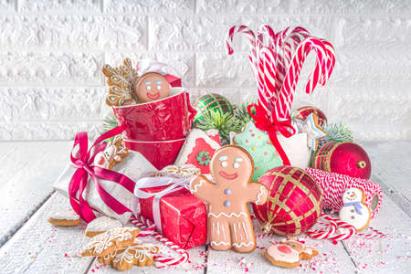 Christmas gingerbread cookies, with festive mugs for hot chocolate, Christmas decor and baubles, white background copy space 版權商用圖片