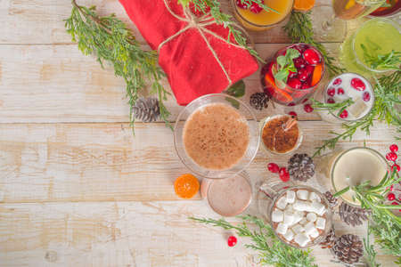 Set of different Christmas and winter drinks. An assortment of Christmas cocktails, hot and cold beverages, in cozy wooden home background with Xmas decor Stock fotó