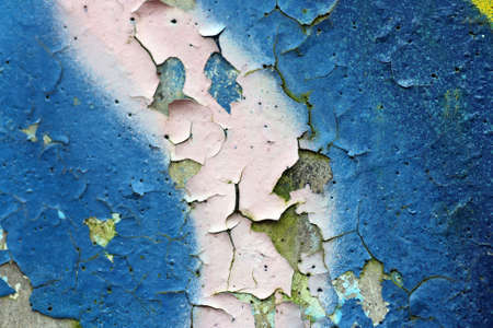 A closeup on flaking graffiti paint Stock Photo