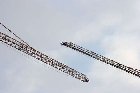 Two lifting cranes against the sky Stock Photo