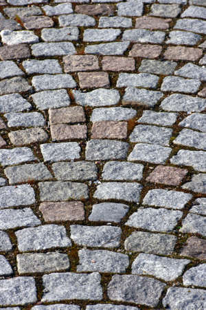 A closeup on old granite paving stones Stock Photo