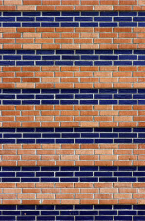 A brick wall in red and blue Stock Photo