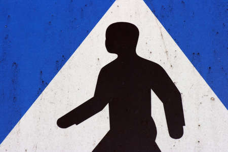 A crosswalk sign in blue, white and black Stock Photo - 2765347
