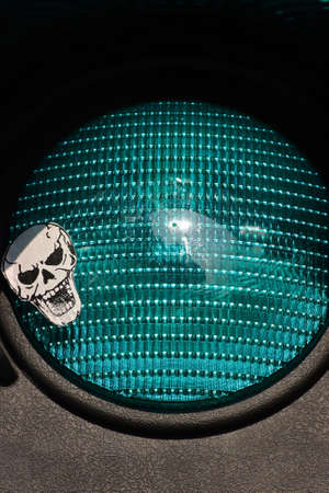 A green light with a skull sticker Stock Photo