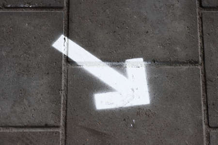 A graffiti painting on a down pointing arrow