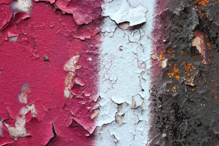 A fcloseup on flaking graffiti paint