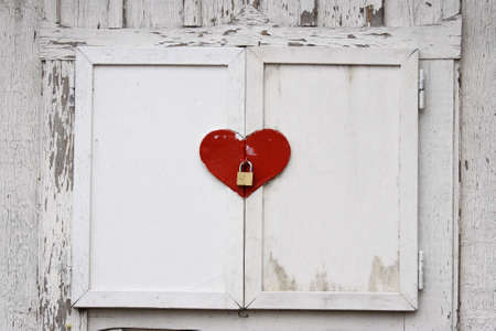 window shutters in heart shape with a locker