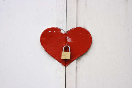 A closeup on a heart shaped window shutter Stock Photo